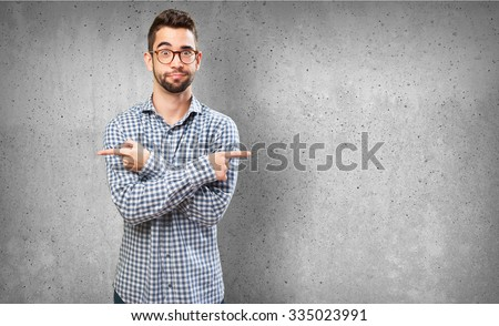 confused man pointing to the copy space - stock photo