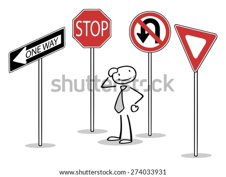 Confused man standing between many different traffic signs - stock photo
