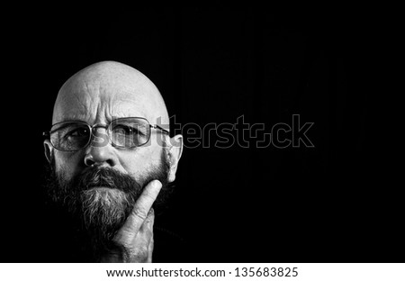 Confused man thinking - stock photo