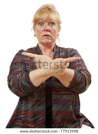 Confused mature woman pointing in opposite directions - stock photo