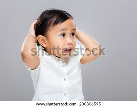 Confused mixed race baby - stock photo