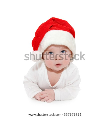 confused 6 month old child wearing Santa's hat for Christmas - stock photo