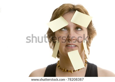 Confused office worker full of adhesive stickies - stock photo