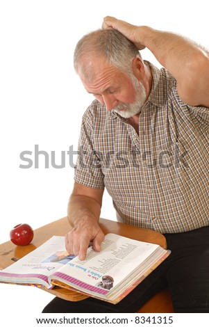 Confused older student at a desk reading a book