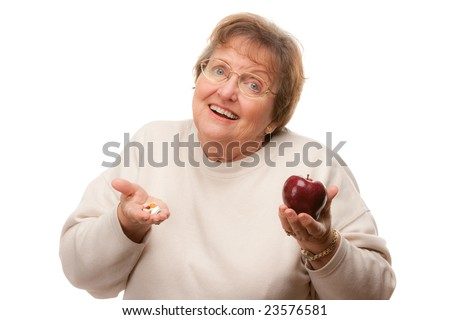 Confused Senior Woman Holding Apple and Vitamins Isolated on a White Background. - stock photo