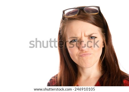 Confused - This is a shot of a cute young woman with a confused look on her face. Shot on an isolated white background. - stock photo