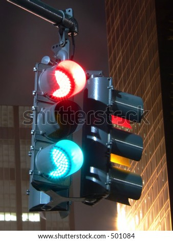 Confused Traffic Light at Night - Long Exposure Photo of signal - stock photo
