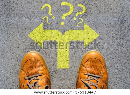 Confused which way to go or choose direction concept - stock photo