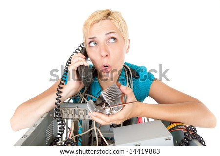 confused woman phoning technology support for computer - stock photo