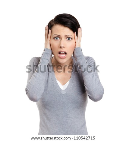 Confused woman puts her hands on the head, isolated on white - stock photo