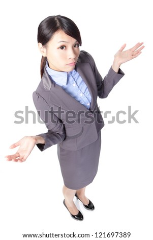 Confused young business woman raise arms in the air in full length isolated over a white background, high angle view, asian beauty model