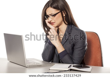 confused young businesswoman looking in her laptop - stock photo
