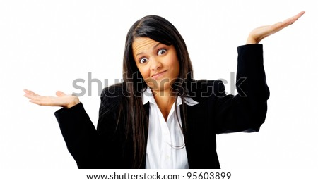 Confused young businesswoman shrugs her shoulders in a clueless gesture - stock photo