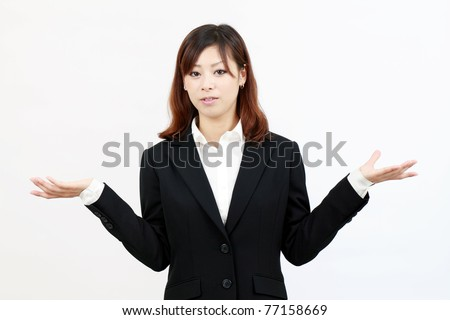 Confused young japanese businesswoman - stock photo