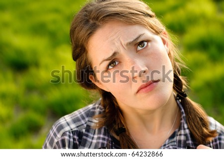 Confused young lass - stock photo