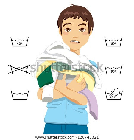 Confused young man having trouble doing laundry chores - stock photo