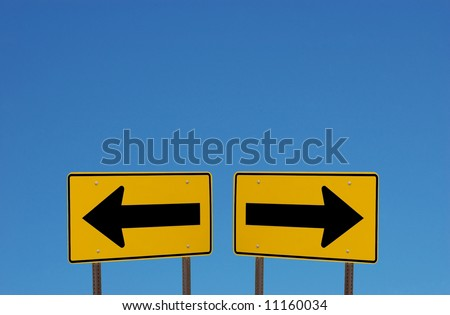 Confusing Direction Signs with Copy Space Above - stock photo