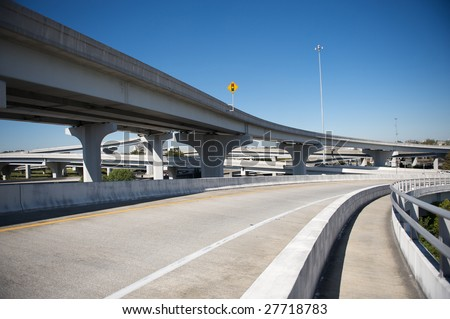 Confusing highway Interchange with overpass. - stock photo