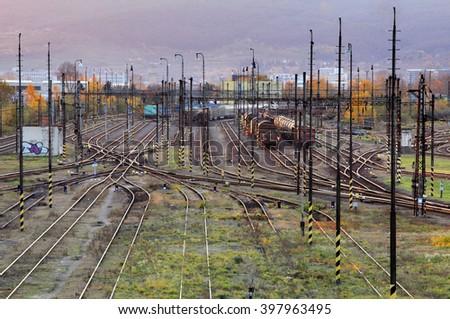 Confusing railway tracks at night. - stock photo