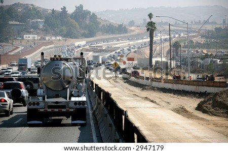 Congested Highway Road Construction on a Foggy Afternoon - stock photo