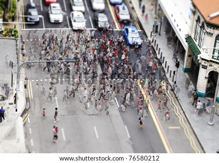 Congested pedestrian crossing at Orchard Road in the heart of Singapore shopping district for the concept of urban humanity. - stock photo
