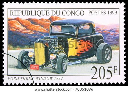 CONGO - CIRCA 1999: A stamp printed in Congo showing vintage car, circa 1999 - stock photo