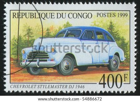 CONGO - CIRCA 1999: stamp printed by Congo, shows retro car, circa 1999. - stock photo