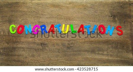 congratulations colorful text on wood board - stock photo