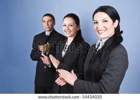 Congratulations!Successful business team people clapping and smiling over blue background - stock photo