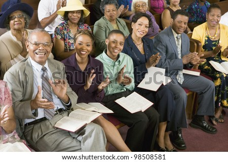Congregation Clapping at Church - stock photo