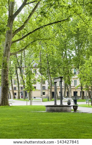 Congress Square outdoor garden park with fountain statue Ljubljana Slovenia Europe - stock photo