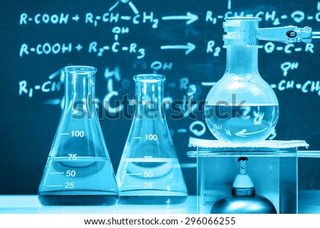 Conical flask and boiling chemical in round bottom flask, laboratory concept