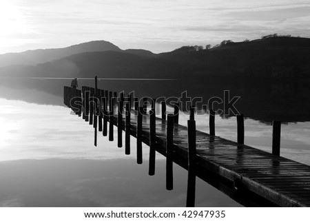 Coniston Jetty in the evening sunlight - stock photo