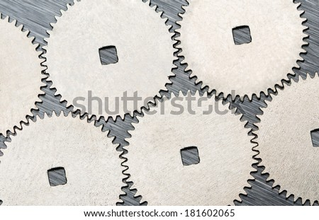 Connected metal cogwheels background, a concept for teamwork and partnership - stock photo