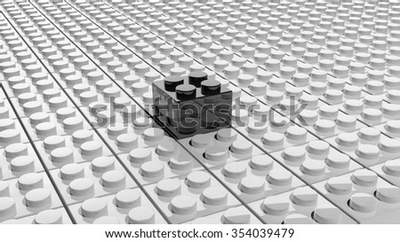 Connected white lego blocks with one black standing out, abstract background. - stock photo