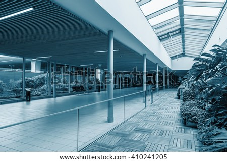 Connecting corridor at the airport. Aerospace and glass. Blue colored. - stock photo