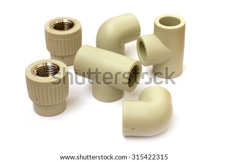 connecting plastic coupling for plumbing pipe - stock photo