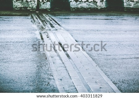 connecting structure of bridge on wet asphalt road - stock photo