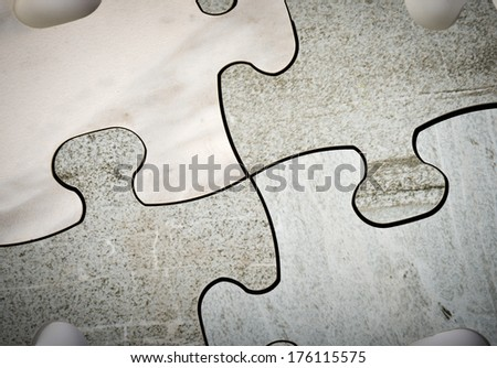 Connecting the jigsaw puzzle - stock photo