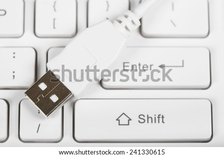 Connecting USB port to laptop computer. Technology - stock photo
