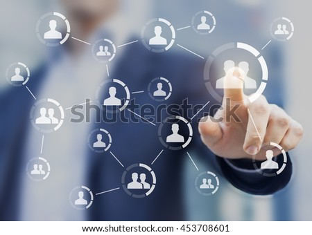 Connections between people displayed on a screen with hand touching icon in background. Concept about friendship and communities - stock photo
