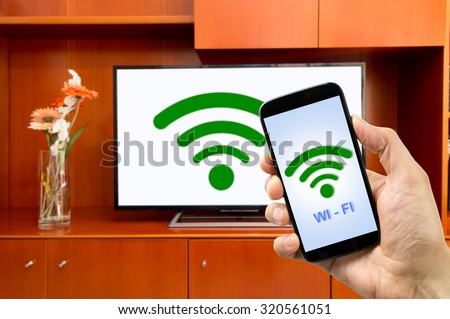 connectivity between smart tv and smartphone through wifi connection - stock photo