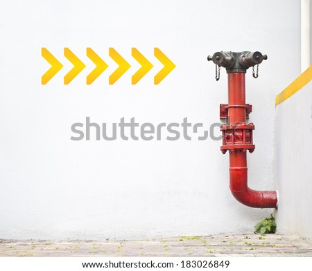 Connector hose fire hydrant on concrete wall - stock photo