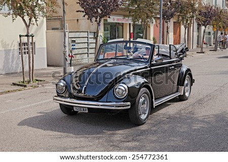 """CONSELICE, RA, ITALY - SEPTEMBER 21: driver on a vintage car Volkswagen Type 1 (Beetle) in rally for classic cars """"Raduno d'auto e moto d'epoca"""" on September 21, 2014 in Conselice, RA, Italy  - stock photo"""