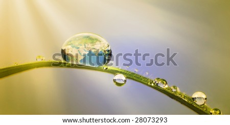 Conservation concept: earth in a droplet with sunrays
