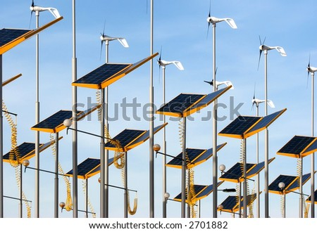 Conserving energy by using wind generators and solar panels - stock photo