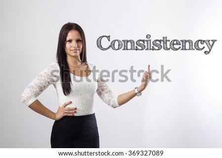 Consistency - Beautiful businesswoman pointing - horizontal image