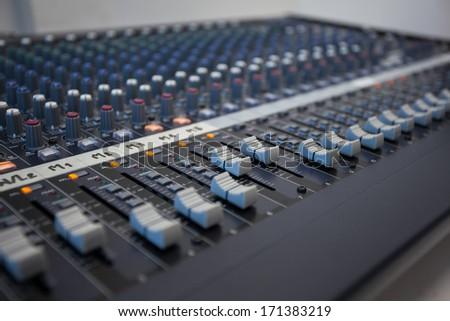 Console audio controls. Sound engineer. - stock photo