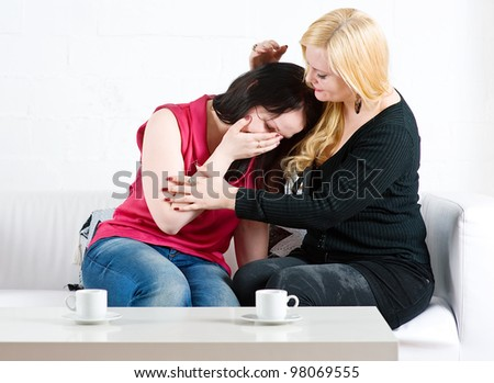 Consoling by friend - stock photo