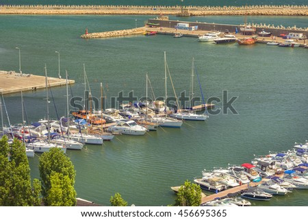 Constanta, Romania - July 18, 2016: Modern yachts and boats in Touristic Tomis Port at The Black Sea in Constanta, Romania. Tomis port is an important attraction in Constanta city for tourists.